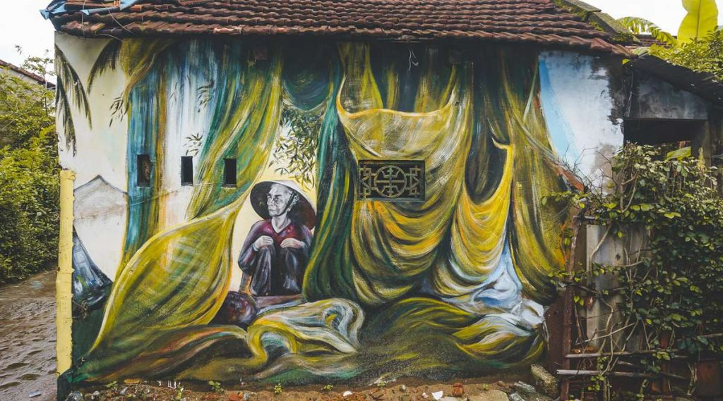 muurschildering dorp Tam Hai